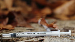 Drug addict's discarded needle (19) Stock Footage