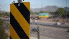 Striped Caution Sign and Desert Highway Scene Stock Footage