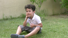 Little boy and mobil phone Stock Footage