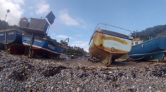 Fishing boats on the shingle beach at Beer in Devon England Stock Footage