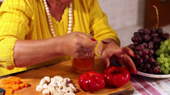 Woman Preparing Pickled Peppers Filled With Grapes Stock Footage