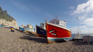 Stock Video Footage of Fishing boats on the shingle beach at Beer in Devon England