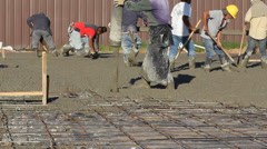 Workers Pour and Smooth Concrete Stock Footage