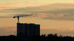 Crane silhouette working at sunset Stock Footage