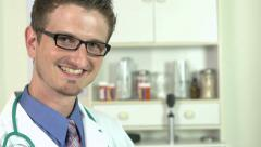 Doctor using tablet tilt to smiling face Stock Footage