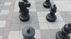 Flying around oversized chess pieces steadycam - stock footage
