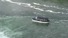 Maid of the Mist in water at Niagara Falls Stock Footage