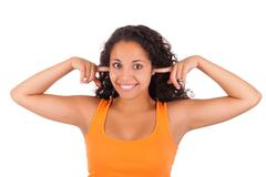 young african american woman putting fingers in ears - stock photo