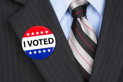 Stock Photo of i voted pin on lapel