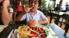 Children eating delicious hamburger Stock Footage