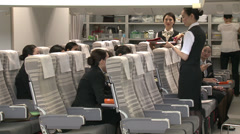 Asian cabin crew in training Stock Footage