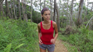 Stock Video Footage of Woman runner trail running on forest path