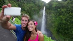 Couple tourists taking self portrait on Hawaii Stock Footage