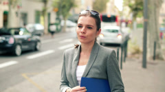 Beautiful businesswoman standing by the city street HD Stock Footage