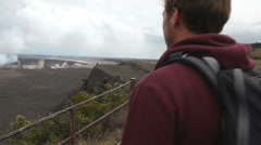 Hawaii - Hiking man looking at Hawaiian volcano Stock Footage