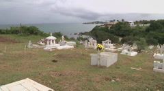 Cemetery pan down from sea Stock Footage