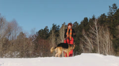 Beauty woman with dog in winter country Stock Footage