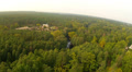 Wood, river and village. Aerial HD Footage