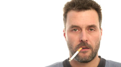 Mature adult man smoking cigarette, closeup - stock footage
