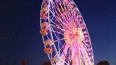 Swing and Ferris Wheel at amusement park time lapse Stock Footage