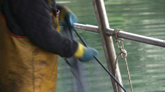 Fishermen cleaning nets 11 Stock Footage