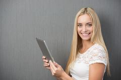 happy beautiful woman with a tablet-pc - stock photo