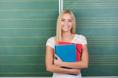 happy pretty young female student - stock photo