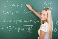 clever confident female student in the classroom - stock photo