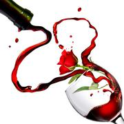 heart from pouring red wine in goblet with red rose isolated on white - stock photo