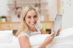 Stock Photo of beautiful vivacious woman with a tablet