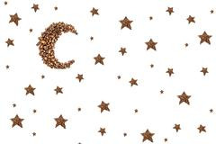 moon and stars from coffee beans isolated on white - stock photo