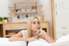 thoughtful attractive young woman - stock photo