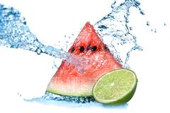 watermelon with lime and water splash isolated on white - stock photo