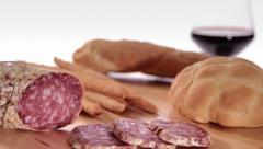 Sliced saucisson with wine and bread Stock Footage