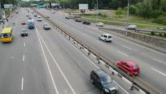 City cars traffic, three lanes street, road junction, daytime Stock Footage
