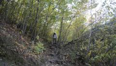man walking along the trail, front view - stock footage