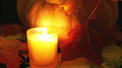 The candle burns before pumpkin. Halloween Stock Footage
