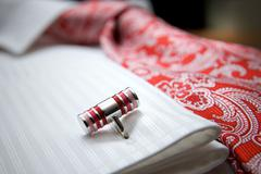 close-up photo of stud on white shirt with red tie - stock photo
