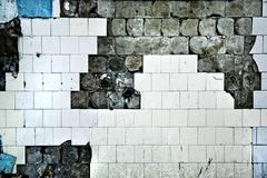 texture of the old tile wall with cracks - stock photo