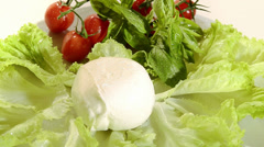 Italian food, mozzarella with tomato and salad Stock Footage