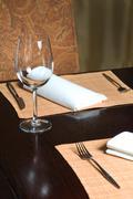 Glass goblet on table Stock Photos