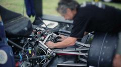 Passionate senior man repairing car Stock Footage