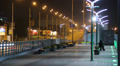 Empty sidewalk pavement in night city time lapse, cars driving Footage