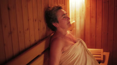 Senior woman relax in sauna Stock Footage