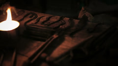 Blacksmith tools at candlelit Stock Footage