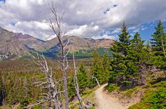 heading up a mountain trail - stock photo