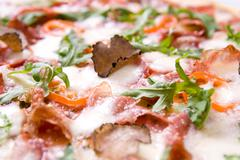 italian pizza with truffels and tomatoes - stock photo