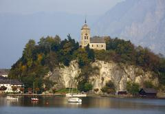 Pictorial church of traunkirchen with traunstein mt austria Stock Photos
