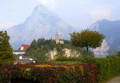 Stock Photo of pictorial church of traunkirchen with traunstein mt austria