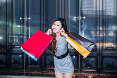 Stock Photo of young woman shopping in mall